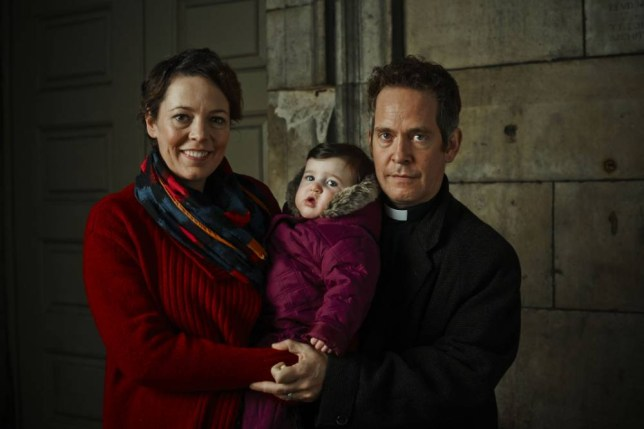 Olivia Colman as Alex and Tom Hollander as Adam with baby Katie in Rev (Picture: Phil Fisk)