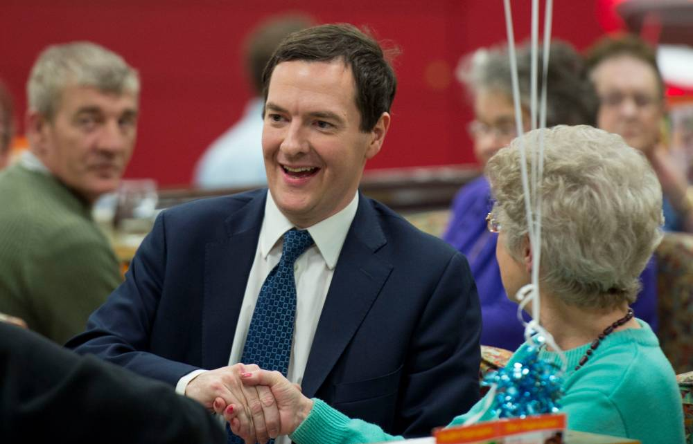 Chancellor of the Exchequer George Osborne during a visit to Castle Bingo in Cardiff, South Wales to see how it has been affected by the budget. PRESS ASSOCIATION Photo. Picture date: Tuesday March 25, 2014. In the Chancellor's budget statement last week he announced a cut in tax on the profits of Bingo halls from 20 per cent to 10 per cent. See PA story POLITICS Osborne. Photo credit should read: Matthew Horwood/PA Wire