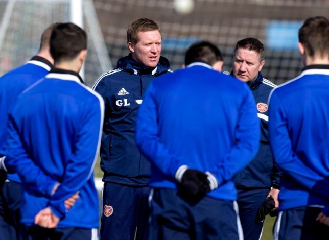 27/03/14 HEARTS TRAINING RICCARTON - EDINBURGH Hearts manager Gary Locke speaks to his players during training.