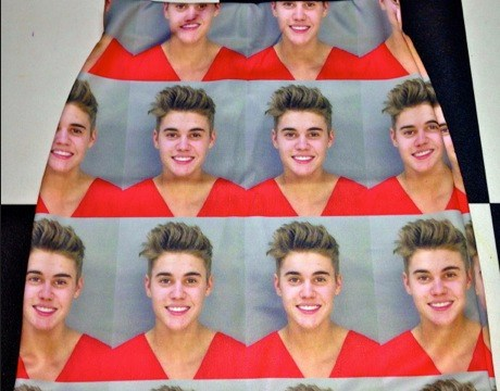Show your support for Justin Bieber by wearing a skirt featuring his police mugshot