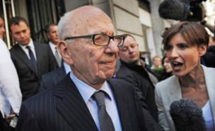 Rupert Murdoch leaves a London hotel after meeting the Dowler family (PA)