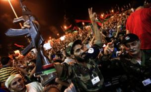 Rebel supporters in Benghazi celebrate news of the assault on Tripoli (AFP/Getty Images)