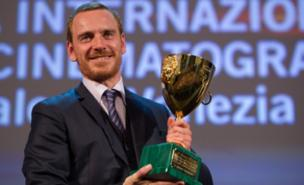 Michael Fassbender collects the best actor honour in Venice (Getty Images)