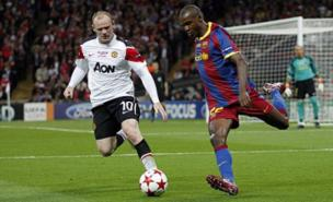 Eric Abidal could soon be on the same side as Wayne Rooney (Allstar)