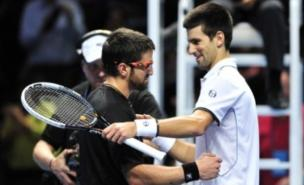 Tipsarevic and Djokovic embrace at the end of today's match - but are their holidays plans still on? (Getty)