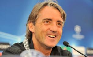 Roberto Mancini has joked about buying Lionel Messi (PA)