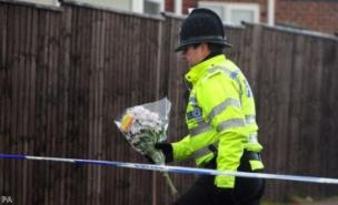 A number of tributes have been left at the home where Atherton killed three members of his family (PA)