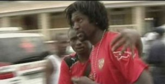 Shocked Togo captain Emmanuel Adebayor in the aftermath of the shooting.