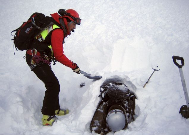 A rescuer digs out 21-year-old Cedric Genoud