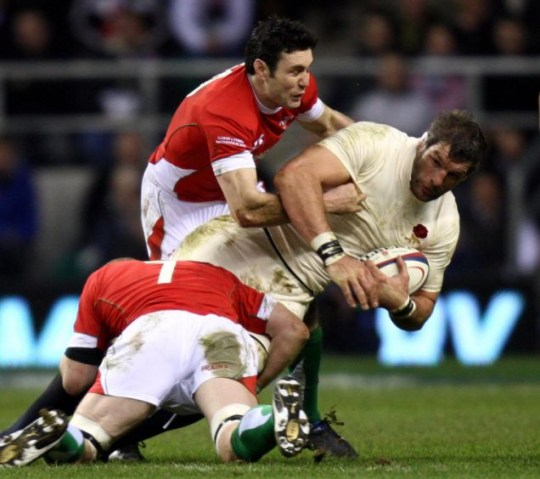England's Simon Shaw is tackled by Wales' Stephen Jones (top) and Martyn Williams