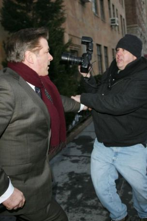 Alec Baldwin wrestles with cameraman
