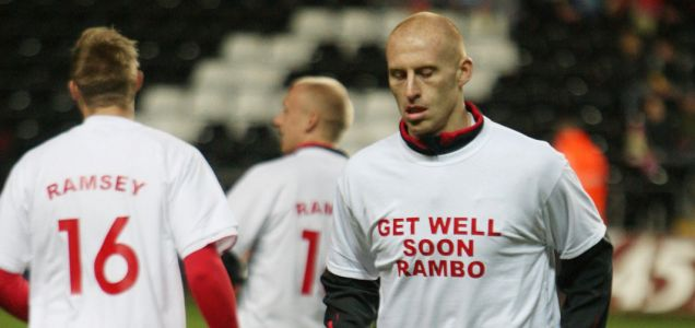 Support: James Collins and his Wales team-mates warmed up in T-shirts bearing a message for colleague Aaron Ramsey, who broke his leg while on Arsenal duty at the weekend
