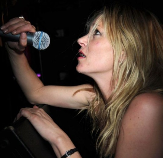 Kate Moss takes to the stage for a bout of karaoke