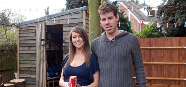 Tilly and James Newman in front of their garden shed, where a Romanian man has been living
