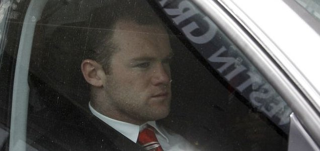 England and Manchester United star Wayne Rooney being driven away from a hotel in Munich