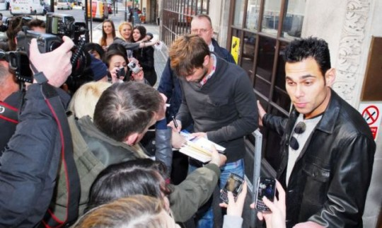 Chace Crawford is mobbed by paparazzi and besotted girls outside the Radio 1 studios