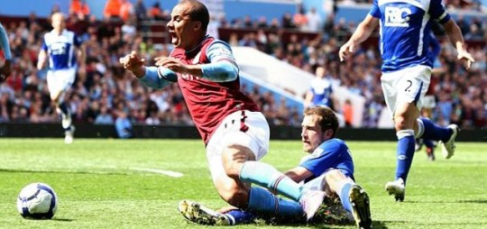 Aston Villa's Gabriel Agbonlahor is fouled by Birmingham City's Roger Johnson resulting in a penalty during the match at Villa Park, Birmingham