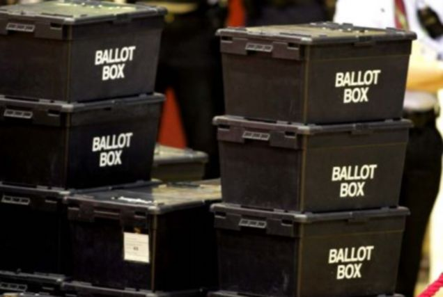Police officer's watch over the unopened ballot boxes before being counted after Britain's General Election at the Leisure center in Newton Aycliffe, northern England, Thursday May 5, 2005. (AP Photo/Scott Heppell)
