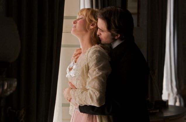 Robert Pattinson cuddles up to Uma Thurman in Bel Ami