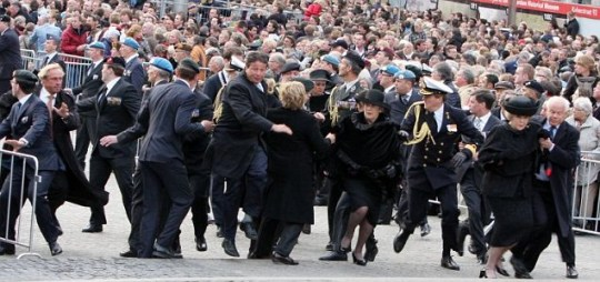 Queen Beatrix of the Netherlands (front left) flees during panic at minute's silence in Amsterdam