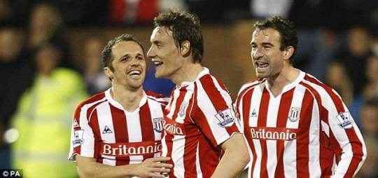 Stoke City's Matthew Etherington (left) celebrates with Dean Whitehead (centre) and Danny Higginbotham