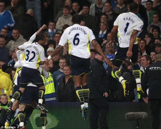 Tottenham players celebrate Peter Crouch's winner against Manchester City