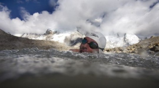 Long-distance swimmer Lewis Gordon Pugh strikes out across a glacial lake on Mount Everest