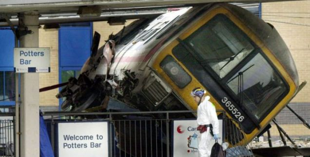Crash scene: The WAGN train lies on its side after the lunch-time accident (Picture: PA)