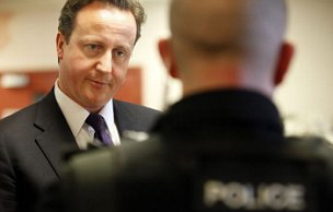 Britain's Prime Minister David Cameron meets senior police officers at Workington Police Station