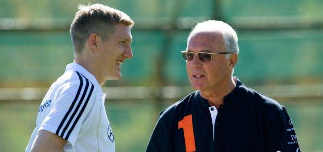 Kaiser chief: Beckenbauer, right, talks to Germany midfielder Bastian Schweinsteiger yesterday  Picture: AP