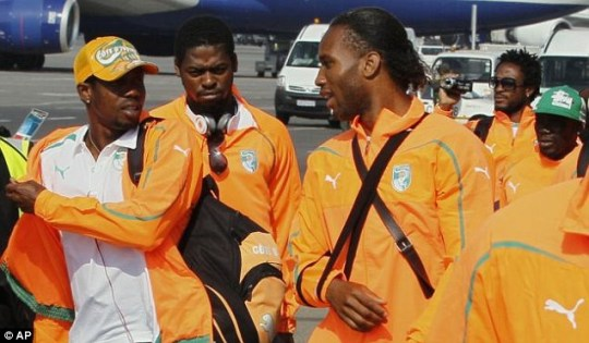 Didier Drogba, with his arm in a sling, feels Ivory Coast are under pressure at the World Cup