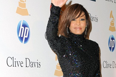 Whitney Houston has voluntarily checked into an out-patient programme, her spokesperson confirmed