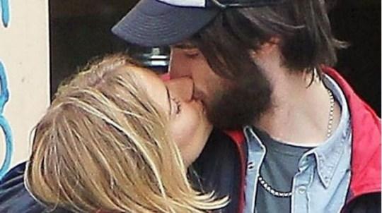 Puckering up: Sienna Miller and boyfriend Tom Sturridge (Picture: Action/Rex)