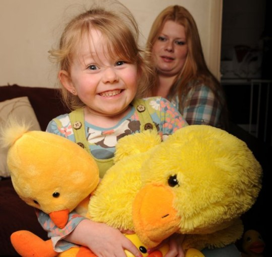 Fear: Scared Vickee Bennett looks on as daughter Katie cuddles her toys (Picture: Caters)
