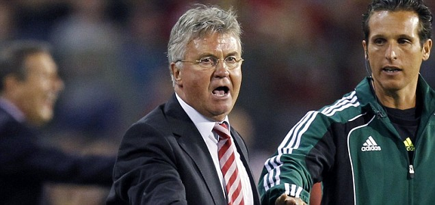 Turkey's coach Guus Hiddink (front L) gestures during their Euro 2012 Group A qualifying soccer match against Belgium at King Baudouin Stadium in Brussels June 3, 2011. REUTERS/Yves Herman (BELGIUM - Tags: SPORT SOCCER)