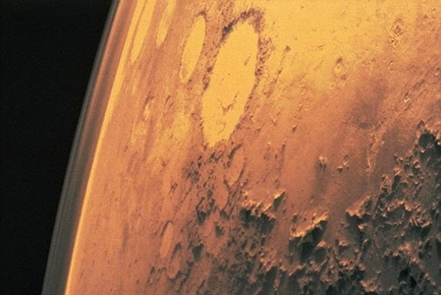 Surface of Mars, taken by Viking 1. The round areas are impact craters where asteroids have hit the planet.  1975. 1975 Mars