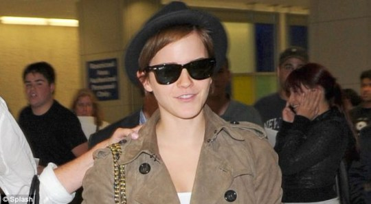 Emma Watson arriving at JFK airport after the Harry Potter premiere