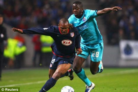 Aly Cissokho challenges Florent Sinama Pongolle of Atletico Madrid