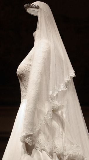 On display: The Duchess of Cambridge's wedding dress, designed by Sarah Burton for Alexander McQueen (PA)