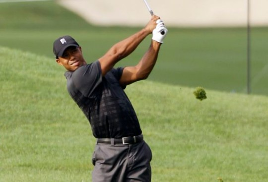 Tiger Woods hits to the ninth green during practice for the Bridgestone Invitational golf tournament