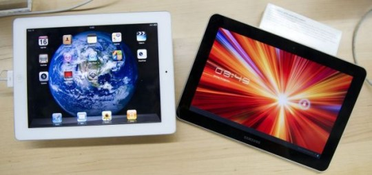 Rivals: the Apple iPad and the Samsung Galaxy Tab (Picture: EPA)