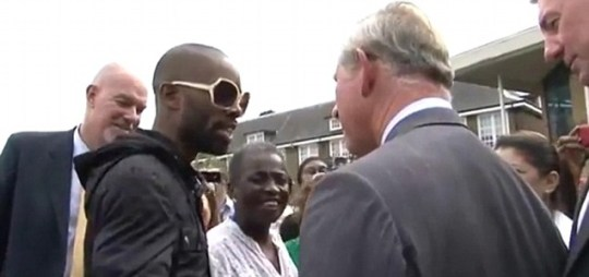 Prince Charles receives a rap CD during his Tottenham visit