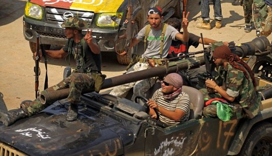 Rebels meet in Gaddafi's Bab al-Aziziya compound in Tripoli
