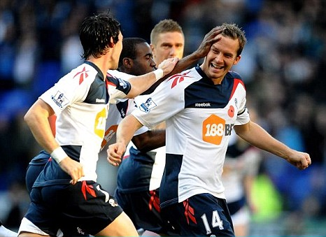 Kevin Davies celebrates with his Bolton teammates