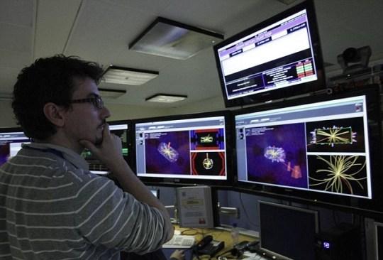 Cern research scientist large Hadron Collider
