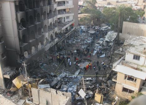 Iraqi security forces gather the scene of a car bomb attack in Baghdad