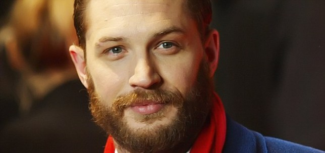 "British actor Tom Hardy arrives for the British Premiere of the film ""This Means War"", in London, on January 30, 2012. AFP Photo / Max Nash (Photo credit should read MAX NASH/AFP/Getty Images)"
