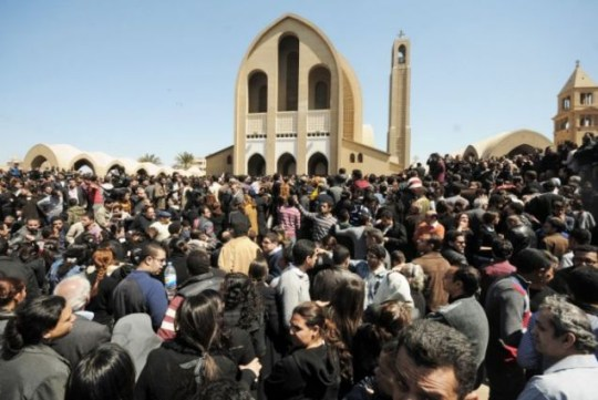 Mourners gather outside the Coptic Orthodox Church for the viewing of the body of Pope Shenouda III