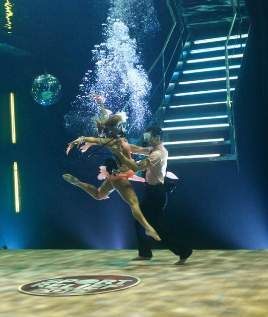 Strictly Come Diving: Harry Judd and Aliona Vilani plunge into the water for an unusual ballroom routine in aid of Sport Relief (Picture: PA)
