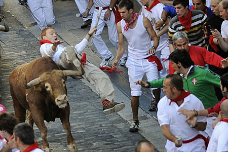 A runner gets too close to a bull